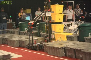 DESTINY holds 3 yellow totes preparing to score coop points during a qualification match.